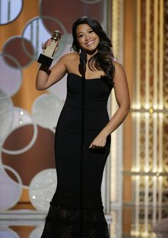 In this image released by NBC, Gina Rodriguez poses with the award for best actress in a T...