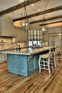 I love turquoise cabinetry...i might actually be able to convince the hubby of this because it's just a small dose!