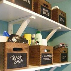 Like the wooden boxes for organizing with the chalkboard paint. Great storage for the laundry room! #storage #laundryroom