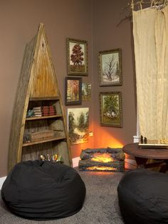 the MODern DAY HUCK finn room for 11 year old ASHer! from our HGTV show! it was BOY paradise! old p-row boat as a shelf, and vintage fireplace logs make a perfect HANG-out spot!   {junk gypsy co, http://gypsyville.com/ }