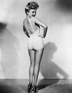 Betty Grable. This photo became the #1 pinup photo off WWII.  Fun fact: It was reported that Grable was pregnant when this photo was taken, which is why she is not facing the camera.