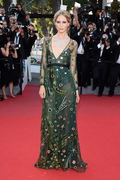 Poppy Delevingne wears a green Burberry Prorsum dress and Chopard jewelry