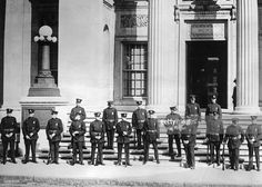 Photo shows the riot squad of the Boston police department guarding the Norfolk County courthouse, at Dedham, Massachusetts, Saturday, during the hearing of a motion for a new trial for Nicola Sacco and Bartolomeo Vanzetti, the two Italian Communists found guilty last June of first degree murder, in connection with the shooting to death of a factory paymaster and guard robbed of $18,000. This case caused the attempt to bomb the American embassy in Paris last week, and Communist…
