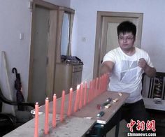 Chinese man blows out candles with energy generated by his punches
