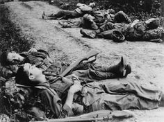WWII soldiers take a short nap, rifle ready, after 48 hours non-stop march along Burma Road. Photographer Unknown.