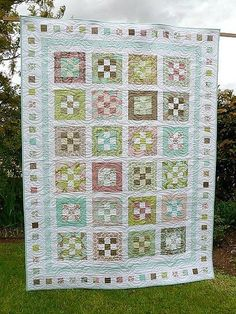 'Sweet Menagerie' nine-patch quilt « Moda Bake Shop...by Roslyn Mirrington of Bloom This easy-to-piece quilt is made from Tula Pink's delicious new line, 'Hushabye'. In her inimitable style, she has cleverly hidden a menagerie of cute creatures in her fabrics ready for you to discover. nine-patch quilt, approximately 66.5″ x 90.5″.