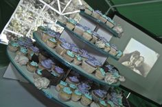 Wedding cupcakes with marshmallow frosting and picture slides of the bride and groom playing in the background at the reception.