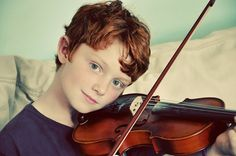 ... magical musical sounds of an 8 year old playing the violin....oh joy