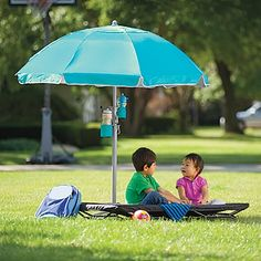 OSA Exclusive!  Ball field, backyard, beach...our self-standing sun umbrella sets up on any surface,