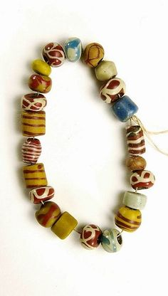 600-675 AD - Medieval necklace of 22 coloured glass beads, found in grave 722 in Rhenen in the province of Utrecht.