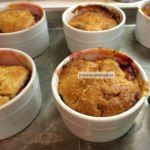 Mmmmmm... I'm definitely in need of some comfort food, and this Peach Cobbler looks divine.