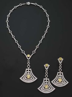 A DIAMOND PENDENT NECKLACE AND EARRINGS, BY GRAFF   The openwork diamond bell pendant with a central radiant-cut fancy intense yellow diamond and surmount weighing 2.16 and 1.03 carats respectively, to the bar and circle link chain, matching ear pendants en suite, mounted in 18k white gold  Earrings signed Graff, no. 4974