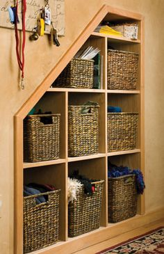 Cool cubbies: open shelves with baskets - 12 Creative Storage Ideas for Under the Stairs - Cabin Life Magazine