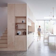 A plywood box hosts the kitchen and staircase in this minimal maisonette in Islington, which has been reconfigured and extended by local architect Larissa Johnston. Find out more on dezeen.com/architecture #architecture #London #house #plywood #kitchen #staircase Photograph by @arorygardiner.