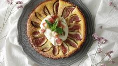 Recipe with video instructions: Move over strawberries, figs are cheesecake's new best friend. Ingredients: (filling), 200g cream cheese, 100g plain yogurt, 90g sugar, 50g cream, 2 eggs, 20g flour (sifted), (crust), 100g graham crackers, 50g melted butter, 1/2 tsp cinnamon, (garnish), 3 figs, whipped cream, confectioners' sugar, mint