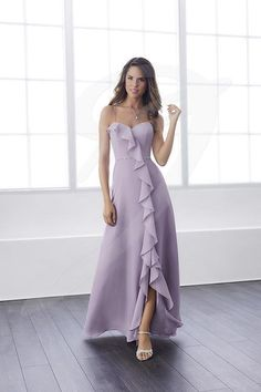 An empire waist chiffon dress with a sensational ruffle trail that ranges from the sweetheart neckline to the hem. Introduces a pretty and thin beaded waist, a low slit trimmed with ruffle chiffon, and a zipper back. Pictured in: Thistle. Taupe Bridesmaid Dresses, Discount Bridesmaid Dresses, Bride Dresses, Formal Dress Stores, Bridesmaids And Mother Of The Bride, Wedding Bridesmaids, Christina Wu, Wedding Dress, Lovely Dresses