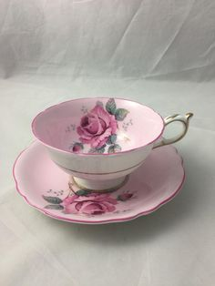 Vintage Paragon fine bone china cup and saucer set. Double pink cup saucer with pink trim decoration. Signed Double Warrant on both cup and saucer By