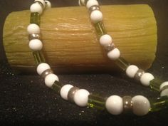 Crisp white round beads compliment clear green and by Bedotted, $32.50