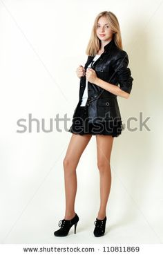https://thumb1.shutterstock.com/display_pic_with_logo/81977/110811869/stock-photo-portrait-of-trendy-teen-girl-in-miniskirt-and-leather-jacket-smiling-against-white-background-110811869.jpg