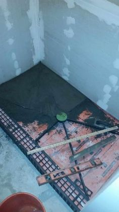 How to build a shower pan yourself. Step by step instructions on how to create a concrete shower pan.