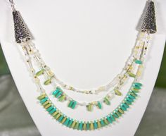 This dramatic multi-strand necklace features turquoise and cream Czech glass dagger beads and Toho Japanese seed beads in a wintry mix. Looks like a museum piece. A tasteful gift for girlfriend or Mom. $25 via Etsy. Get 15% off your entire SmallestPlanet purchase with coupon code PIN15.