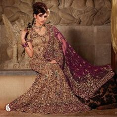 Bridal Lehenga -- Awesome beige and burgundy pure georgette net fish cut lehenga with thick border and broadning downwards embroidery. Hand work beautifully studded with nakashi, dubka, zircon, sequins, beads , resham work and shimmering sequins in paisley designed are amplifying its beauty.The matching beige choli and burgundy dupatta is also hand embroidered with heavy jaal of floral and paisley design.Explore the new style in fashion with this lehenga choli. $1404