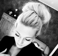 high chignon, keep it messy girls... imperfection is perfection