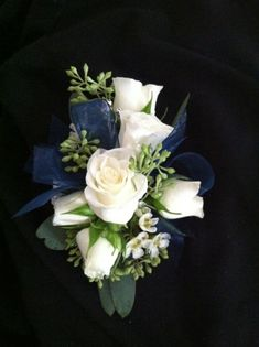 This is the shape and general size of our wrist corsages; will use an ivory ribbon with these mixed greens and white wax