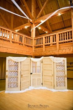 CALL ME AT 801.427.2276 TO RENT THIS OR FOR A FREE CONSULTATION    Love the 5 little vintage doors for a wedding reception.  Draped with lace to soften the edges and give this wedding a perfect little romantic backdrop.