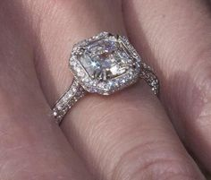 Gorgeous low profile Asscher cut engagement ring with halo setting:
