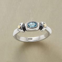 BETWEEN BEADS RING--Faceted blue topaz shines like a patch of clear sky between beads of 14kt gold. Hand cast in sterling silver exclusively for Sundance. Whole sizes 5 to 9.