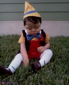 Trying to get his shoes off . Pinocchio - Homemade costumes for babies