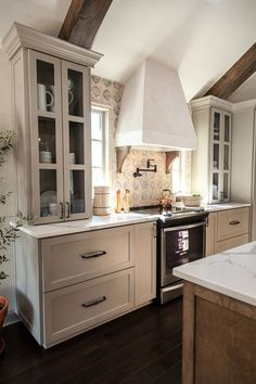 I like the way the cabinetry and the cooktop, hood, and backsplash all came together in this. I love the cabinets that sit on the countertop
