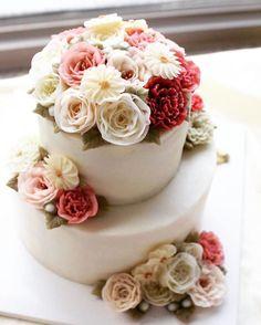 butter cream blossum 2-tier flowercake. Done by G.G.CAKRAFT