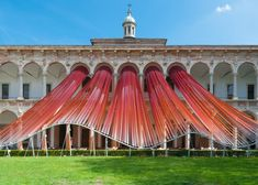 dezeen: MAD stretches gradated ribbons from palazzo arcade for Invisible Border installation