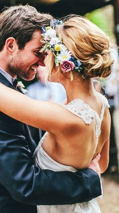 Bride's loose messy bun bridal hair Wedding hairstyle ideas flower crown Romantic wedding photography