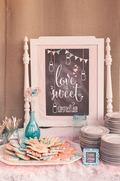 """One of our lovely dessert tables with custom """"Love is sweet"""" sign by Dandelion Willows Invitations + Stationary and Photo by Intuition Photography Dessert Tables, Love Is Sweet, Intuition, Stationary, Dandelion, Wedding Planning, Backyard, Invitations, Sign"""