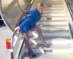 Female Flight Attendant in blue dress in Gray pantyhose