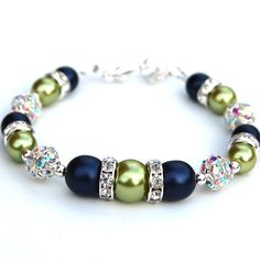 Perfect colors for brides maid jewlrey! @Sarah Chintomby Chintomby Chintomby Chintomby Brinker  Navy and Lime Green Pearl Rhinestone Bracelet by AMIdesigns, $24.00. It comes in purple :)