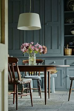 This green-meets-blue-meets-gray hue is popping up in more and more kitchens.