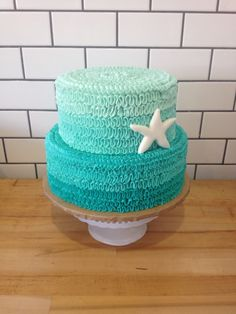 Ombre ruffled under the sea/mermaid themed cake with starfish.