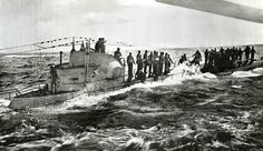 Waves crash over the side of another surrendered U-boat as hard-luck German sailors await pickup by the destroyer USS Fanning (DD-385).