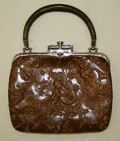 Cherub embossed leather purse ca. 1886