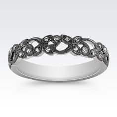 This sparkling wedding band is part of our exclusive Noire collection and is crafted from quality 14 karat white gold with a rich black rhodium finish.
