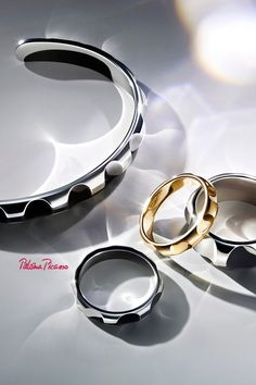 Paloma's Groove™ cuff and rings in titanium and 18k gold.