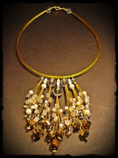 handmade necklace made of plastic beads, glass beads and gold plated metal wire