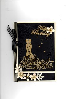 Tattered Lace red carpet dress and happy birthday cut in gold metallic.  Flowers and leaves hand punched. Card by Sue Elvin