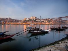 Photograph by Michael Melford    Port produced in the Douro Valley was once shipped downriver to the city of Porto in sailboats called barcos rabelos, anchored here along the Douro River.