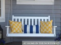 These colors would go great with a Navy or Yellow front door. Would want to paint the swing the same color has the door not white