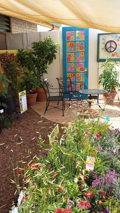A display garden for the 2014 Sonoma County fair.  The painted door was inspired by the 60s theme. The garden was based on sustainable principles.